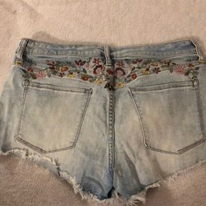 Embroidered cut offs